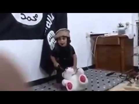 VIDEO: Smadzeņu skalošana Islāma valsts gaumē! (What? ISIS Video shows Young Boy Practicing Beheading on his Teddy Bear Stuffed Animal)